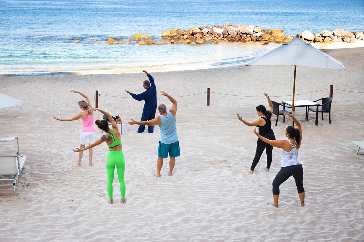 yoga and tai chi on the beach